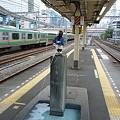 写真: 浜松町駅の小便小僧