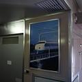 写真: 便所付近の広告枠に0系新幹線